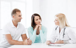 Doctor with patients in cabinet Stock Image