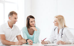 Doctor with patients in cabinet Royalty Free Stock Photo