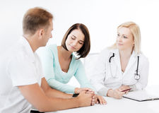 Doctor with patients in cabinet Royalty Free Stock Images