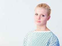 Doctor with a patients gown Royalty Free Stock Photo