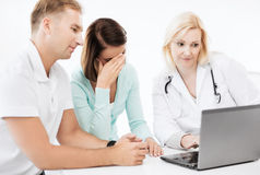 Doctor with patients in hospital Royalty Free Stock Image
