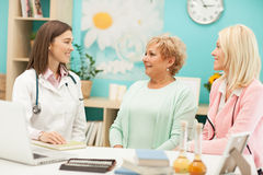 Doctor and Patients Stock Photo