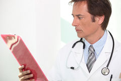 Doctor with patients results Royalty Free Stock Photography