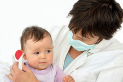 Doctor pediatrician and baby girl Royalty Free Stock Photos