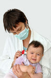 Doctor pediatrician and baby girl Stock Photo