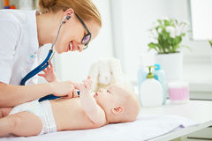 Doctor pediatrician and baby patient. In clinic royalty free stock photos
