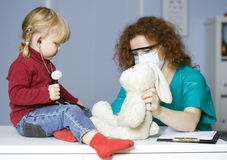 Doctor pediatrician and little girl Royalty Free Stock Photos