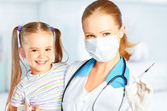 Doctor a pediatrician makes child vaccinated. Vaccination Royalty Free Stock Photos