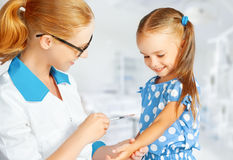 Doctor a pediatrician makes child vaccinated Royalty Free Stock Images