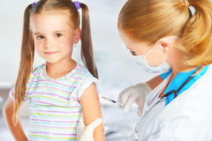 Doctor a pediatrician makes child vaccinated Stock Image
