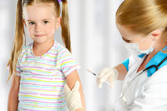 Doctor a pediatrician makes child vaccinated Royalty Free Stock Image