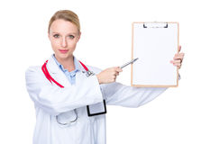 Doctor pen point to clipboard Royalty Free Stock Image