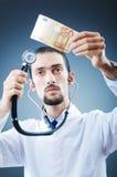 doctor pengar arkivfoto