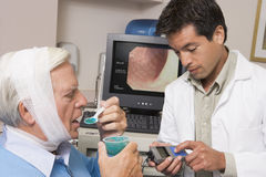 Doctor Performing Laryngoscopy On Patient Royalty Free Stock Photography