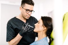 Doctor performing lip surgery using hyaluronic acid Royalty Free Stock Photo