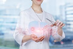 A doctor performing liver treatment royalty free stock image