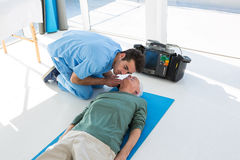 Doctor performing resuscitation on patient. In the clinic Royalty Free Stock Images