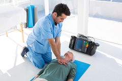 Doctor performing resuscitation on patient. Close up of doctor performing resuscitation on patient royalty free stock photography