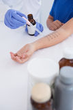 Doctor performing a skin prick test Royalty Free Stock Image