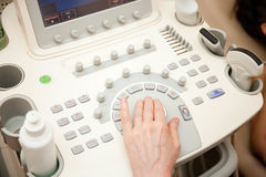 Doctor performing an ultrasound examination Royalty Free Stock Photo