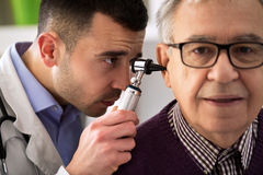 Doctor Performs an Ear Examination Stock Image