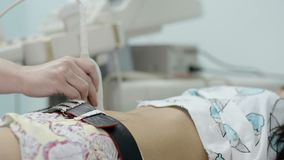 Doctor performs an ultrasound examination. Of the patient stock footage