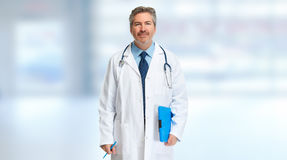 Doctor pharmacist. Doctor pharmacist man over blue abstract background royalty free stock images