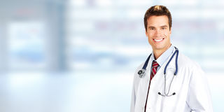 Doctor pharmacist. Doctor pharmacist man over blue medical clinic background stock photography