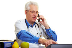 Doctor on the phone Royalty Free Stock Image
