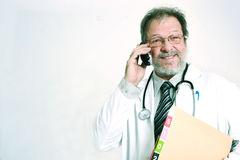 Doctor on phone Stock Photos