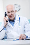 Doctor on the phone Stock Image