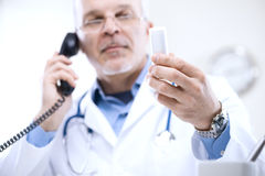 Doctor on the phone Stock Images