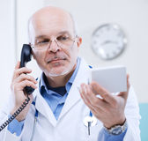 Doctor on the phone Royalty Free Stock Photo
