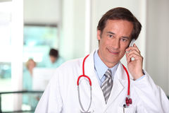Doctor on the phone Stock Photography