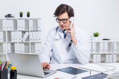 Doctor on phone Royalty Free Stock Photo