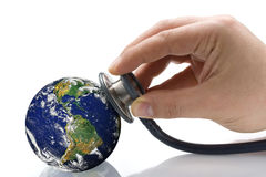 Doctor Phonendoscope Examining Earth s Condition. Male hand phonendoscope auscultating planet earth over white Stock Photography