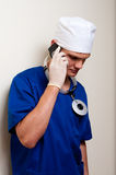 Doctor phoning client with Royalty Free Stock Photos