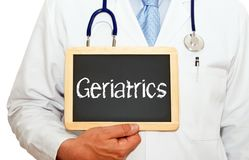 Doctor with Geriatrics chalkboard. Doctor or Physician with Geriatrics chalkboard on white background Royalty Free Stock Photo