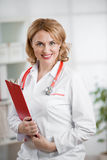 Doctor or physician in her office. Doctor or physician woman in medical office Stock Photography