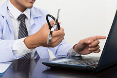 Doctor, physician holding stethoscope showing medical records on Royalty Free Stock Photography