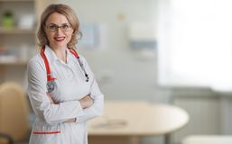 Doctor or physician woman in office Royalty Free Stock Photos