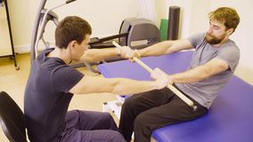 Free Doctor Physiotherapist Helping The Patient To Do The Exercise Royalty Free Stock Images - 128870429