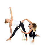 Doctor physiotherapist stretching a young sport woman Stock Photos