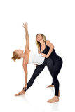 Doctor physiotherapist stretching a young sport woman Stock Photo