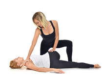 Doctor physiotherapist stretching a young sport woman Stock Photography