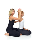 Doctor physiotherapist stretching a young sport woman Royalty Free Stock Images