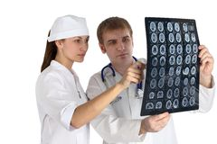 Doctor & picture. Doctor studies picture x-ray medicine isolated Stock Photography