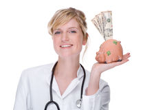 Doctor with piggybank (dollar) Stock Image
