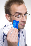 Doctor with pills Royalty Free Stock Photos