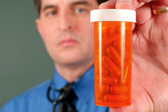 Doctor with Pills Royalty Free Stock Images